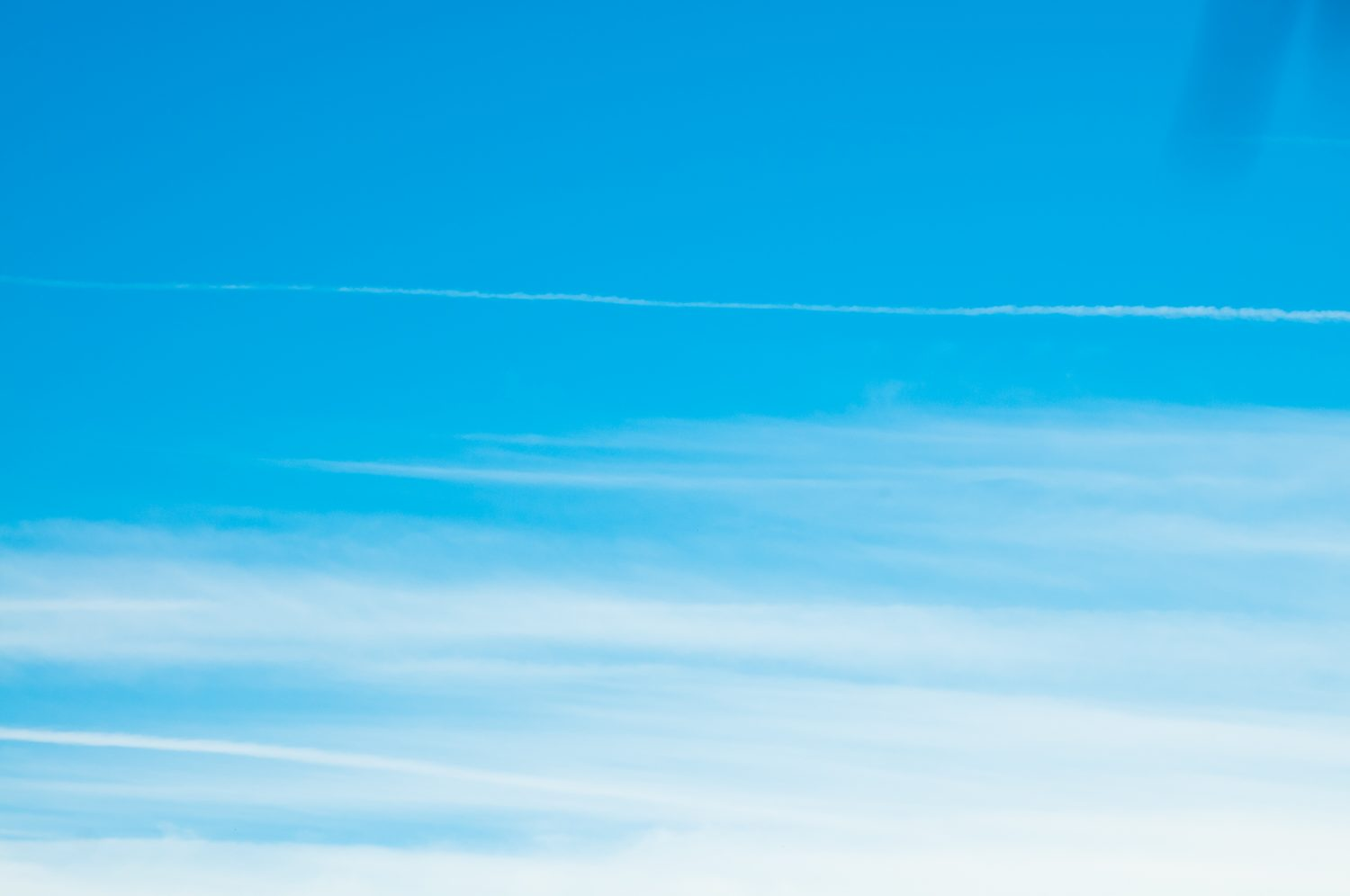 Abstract striped clouds blue sky