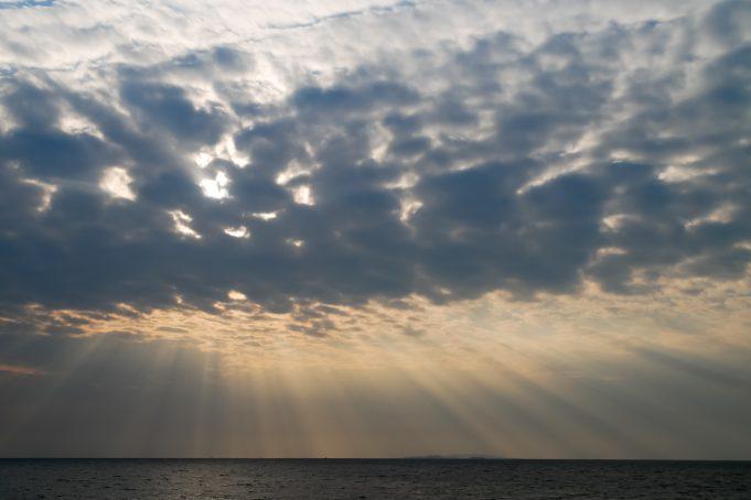 African sunbeams piercing cloudy sky