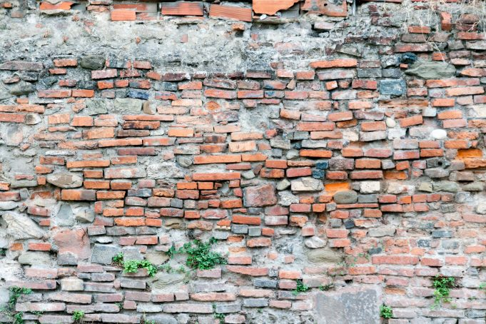 Badly stacked brick wall background