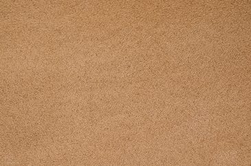 Beige carpet texture closeup background