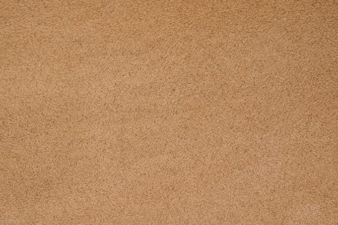 Beige carpet texture closeup background