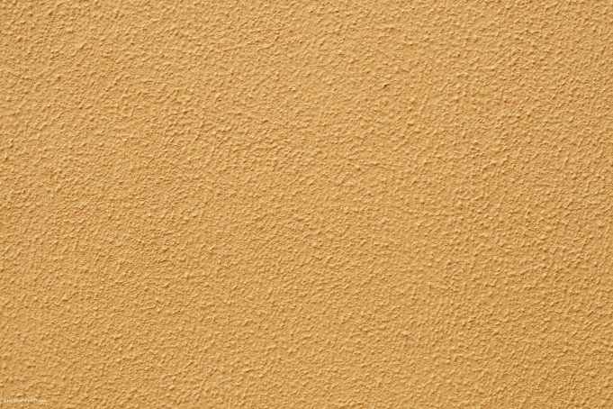 Beige plaster wall detailed structure