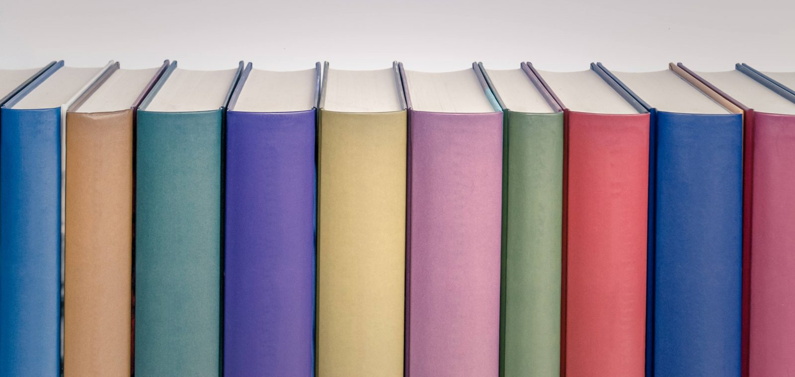 Blank book spine row in various colours