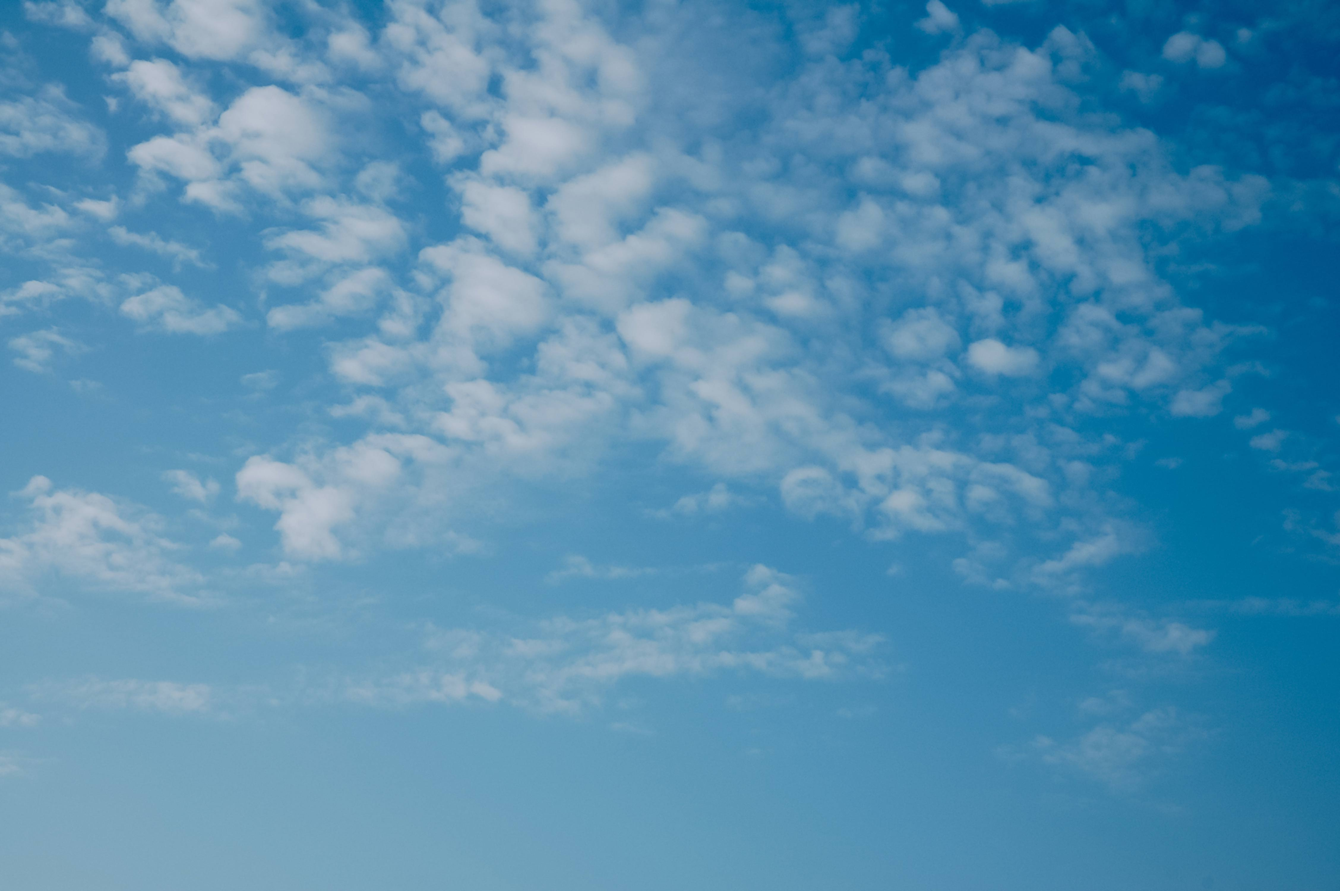Blue sky with tiny clouds