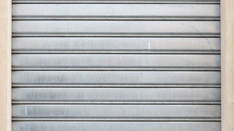 Closed metal shop shutter door