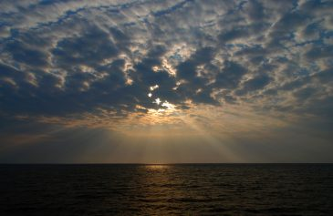 Cloudy Sunset and Sunbeams over Lake Victoria