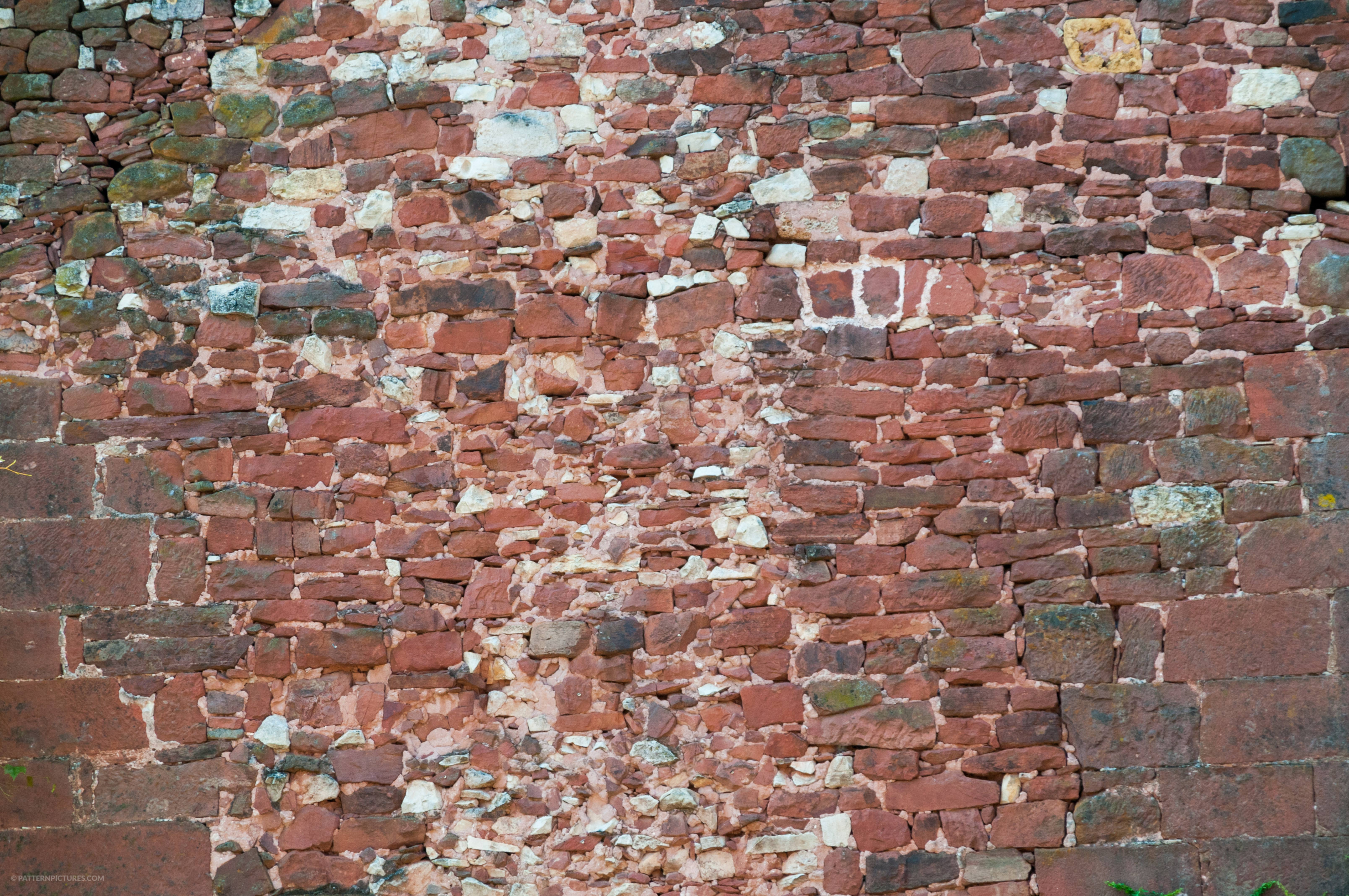 Collected bricks and stones wall background