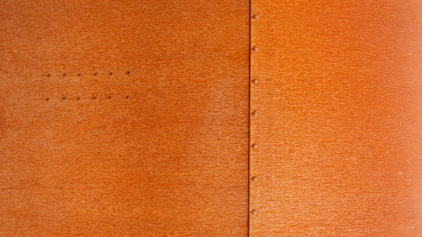 Corten steel plates background and bolts