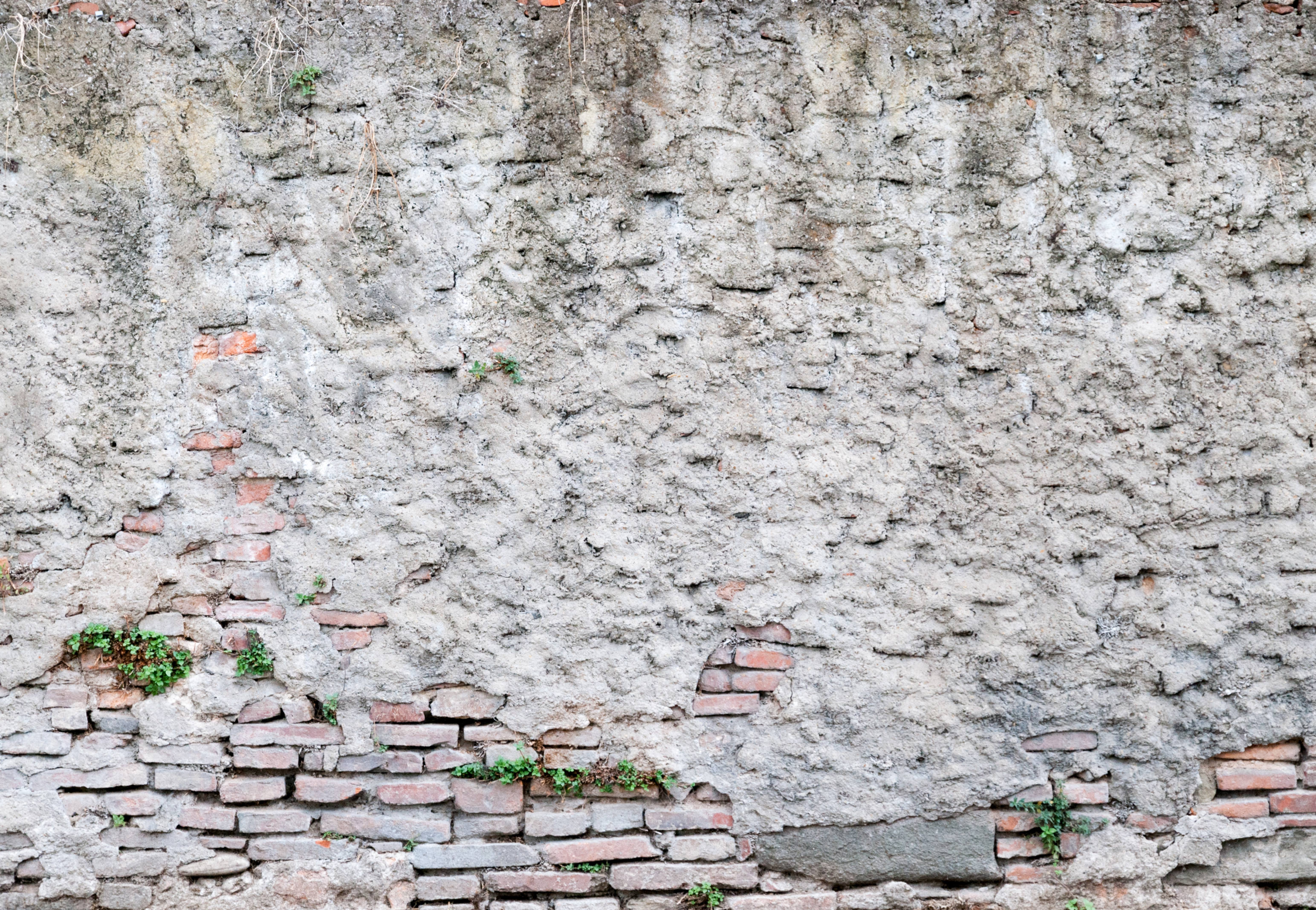 Cracked concrete old brick wall background