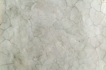 Cracked paint white stone wall