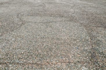 Cracked street covered with small stones