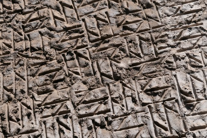 Criss cross pattern carved in cement