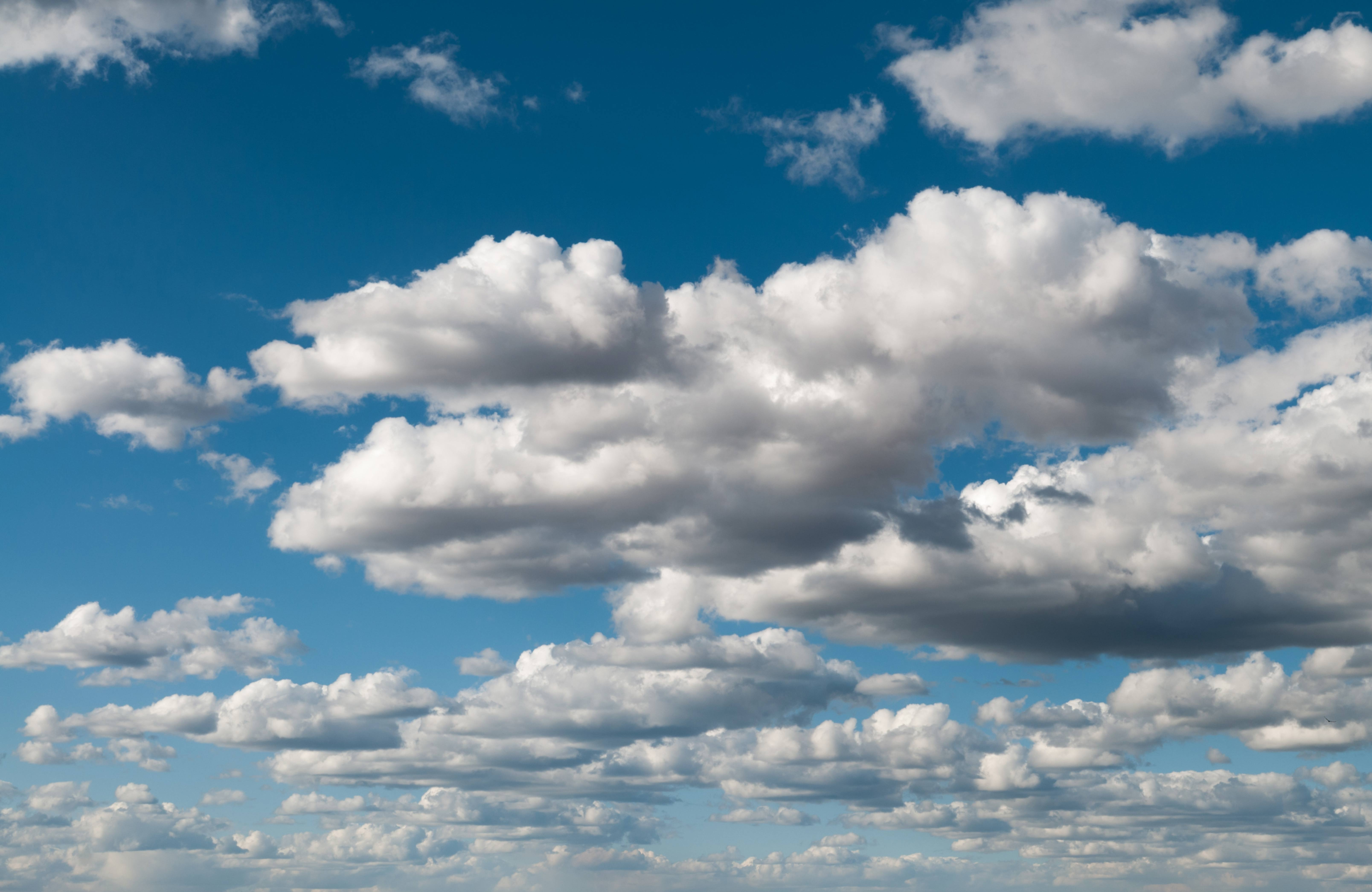 Cumulus clouds in blue sky panorama