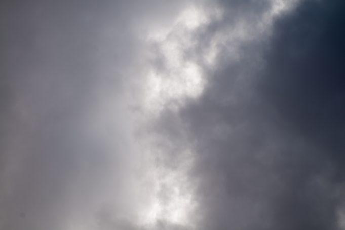 Dark clouds break