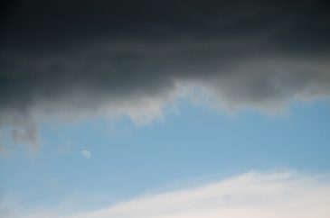 Dark clouds moon and blue sky
