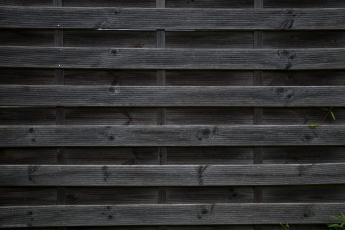 Dark wooden fence background