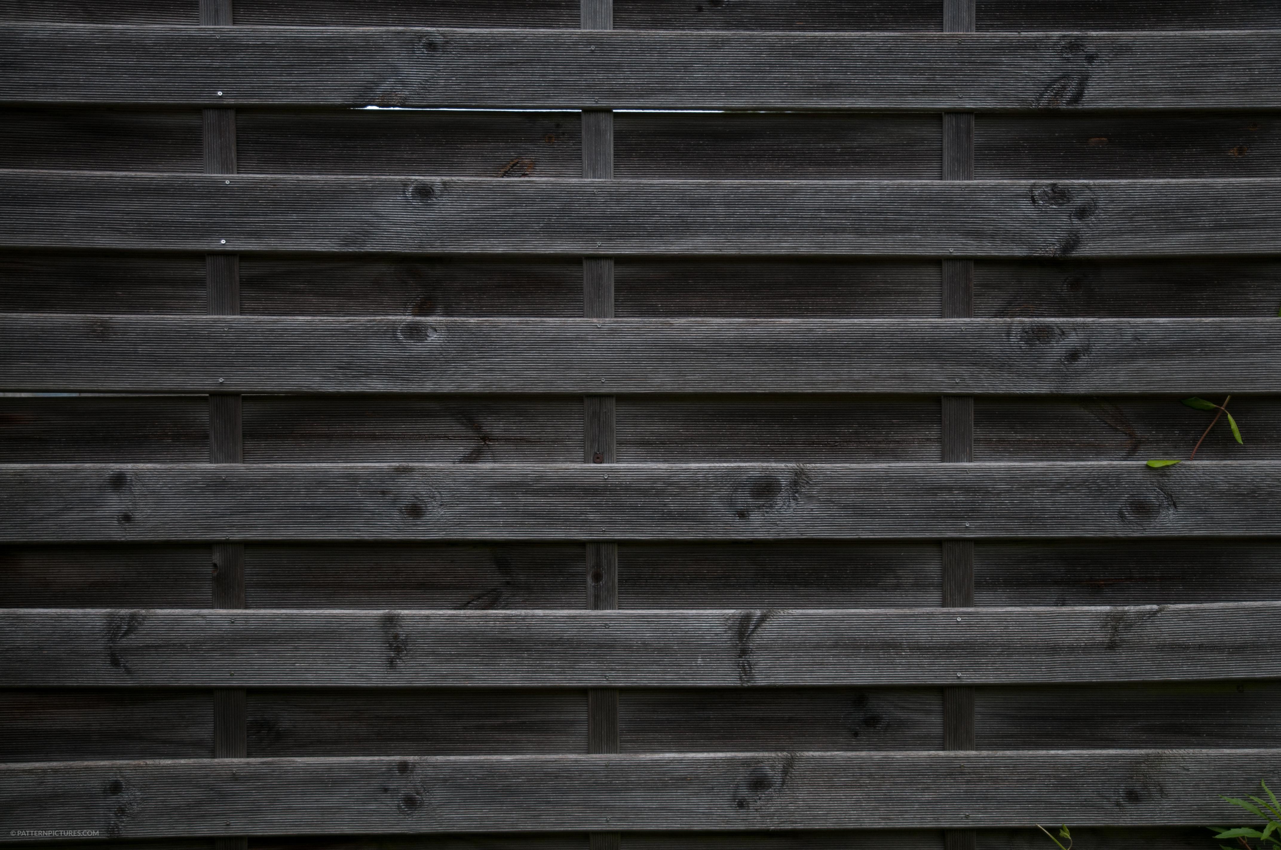 Dark wooden fence background