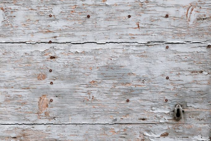 Decaying wooden door texture with keyhole