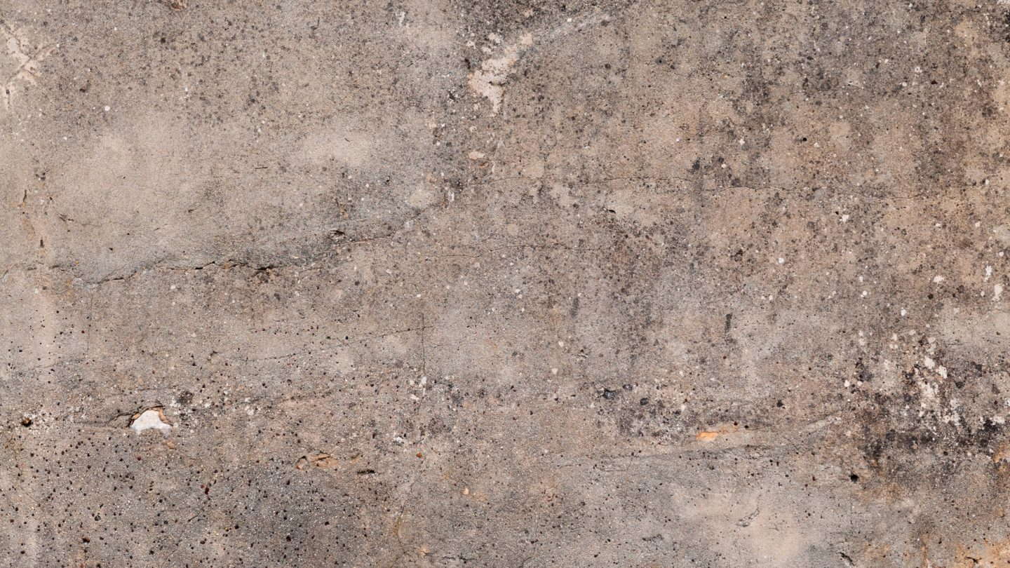 Dirt covered grunge cracked stone wall
