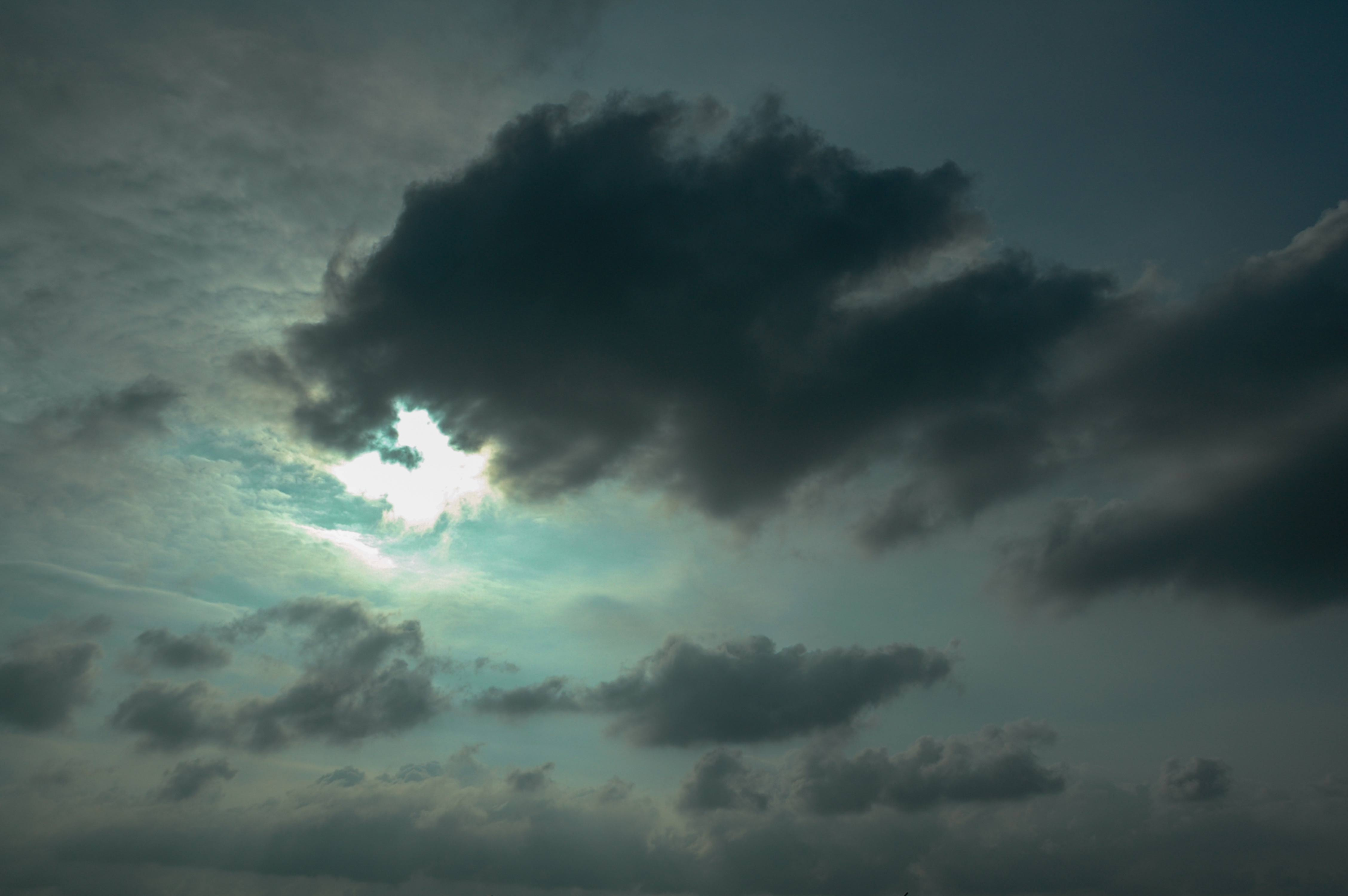 Dramatic Grey Sky with Sunlight and Dark Clouds