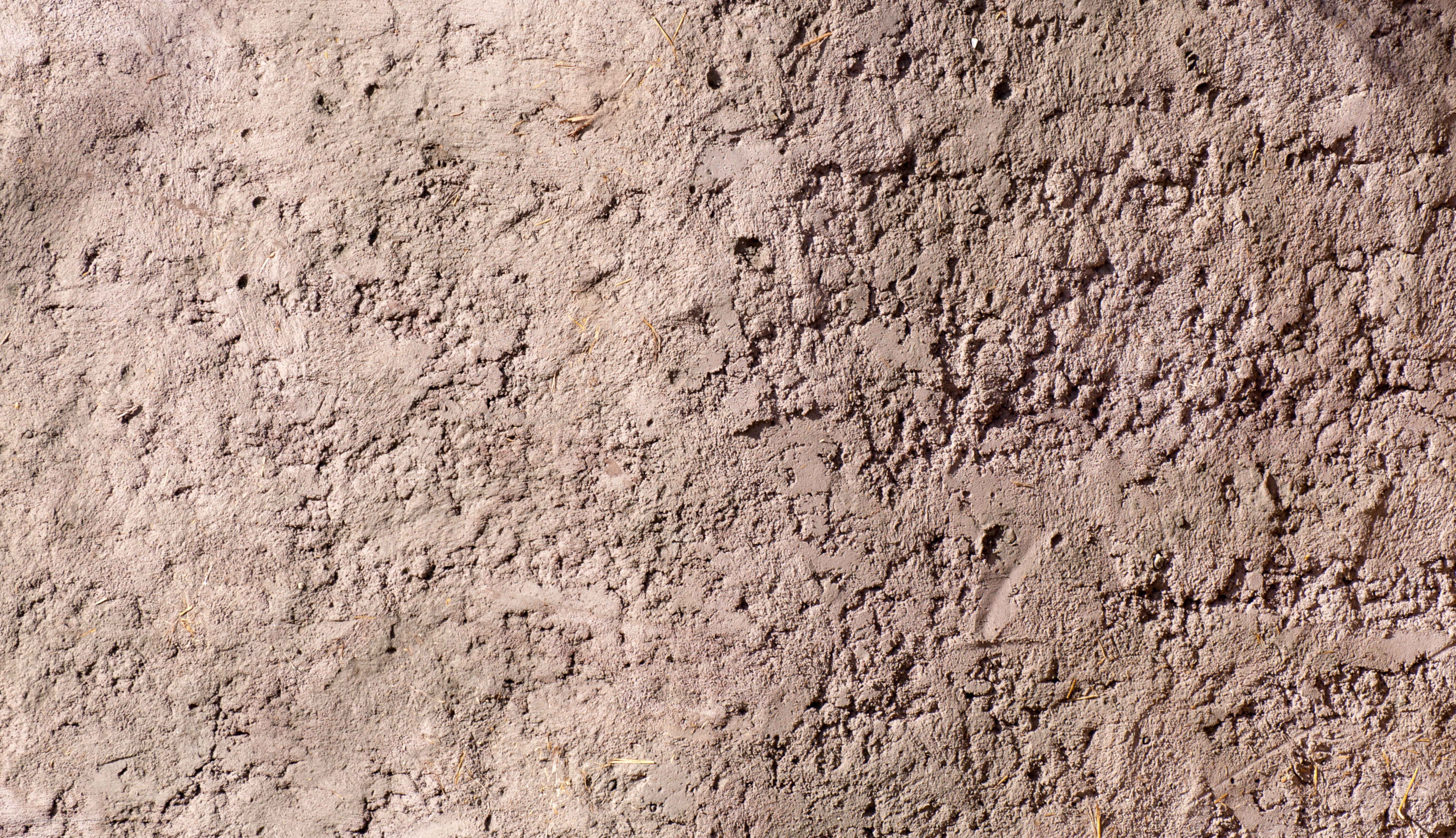 Dried clay straw wall background