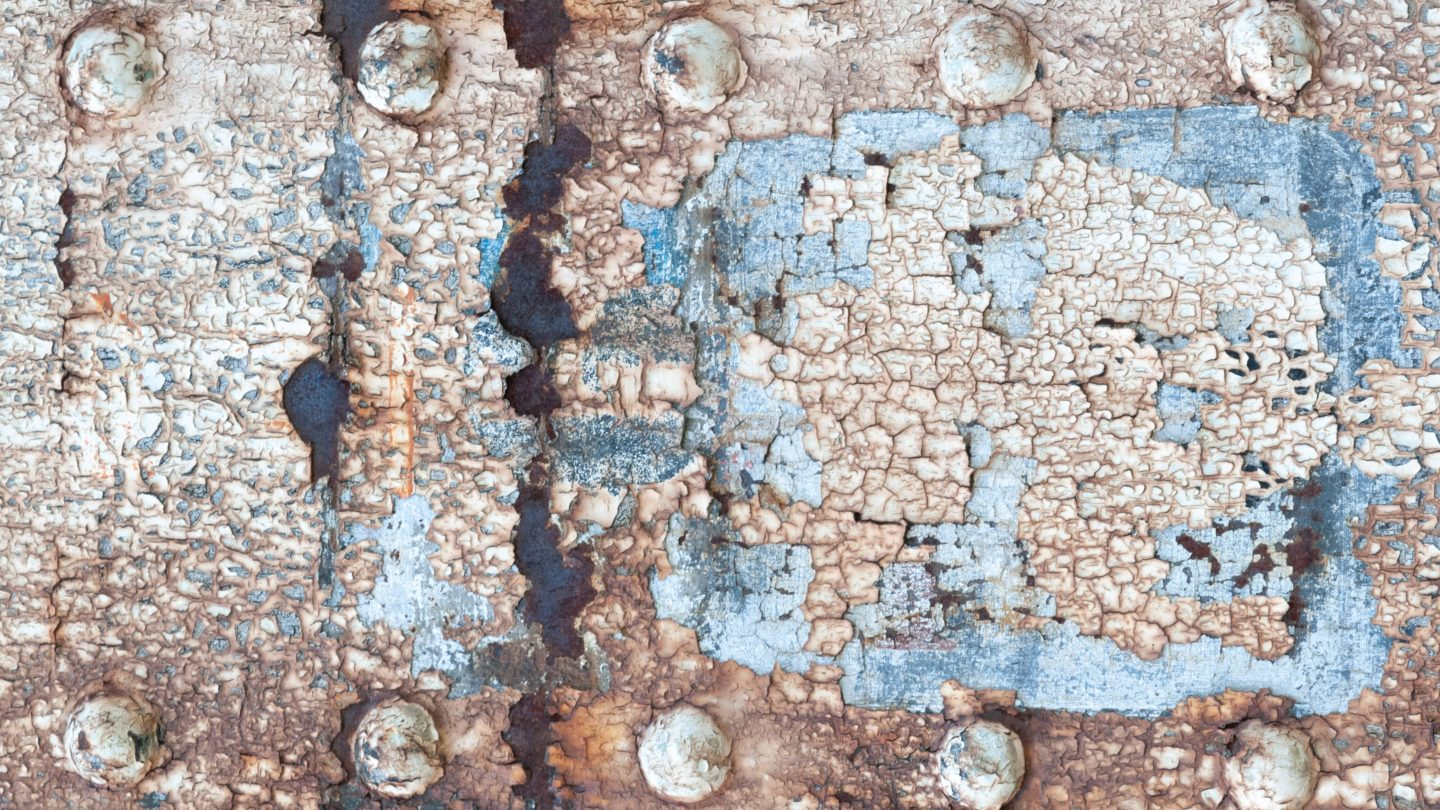 Eroded rusty metal surface with bolts