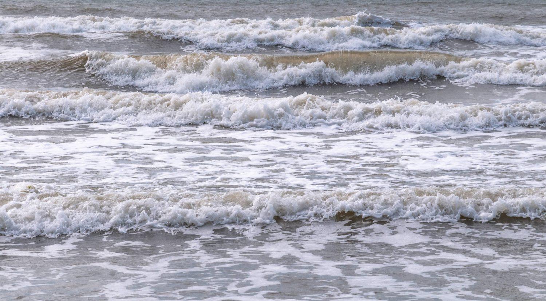 Foam waves at the beach sea free background photo