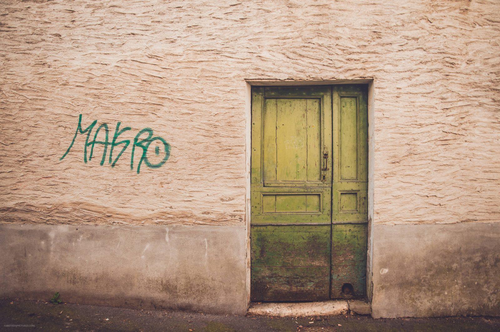 Green door and grafiti urban scene