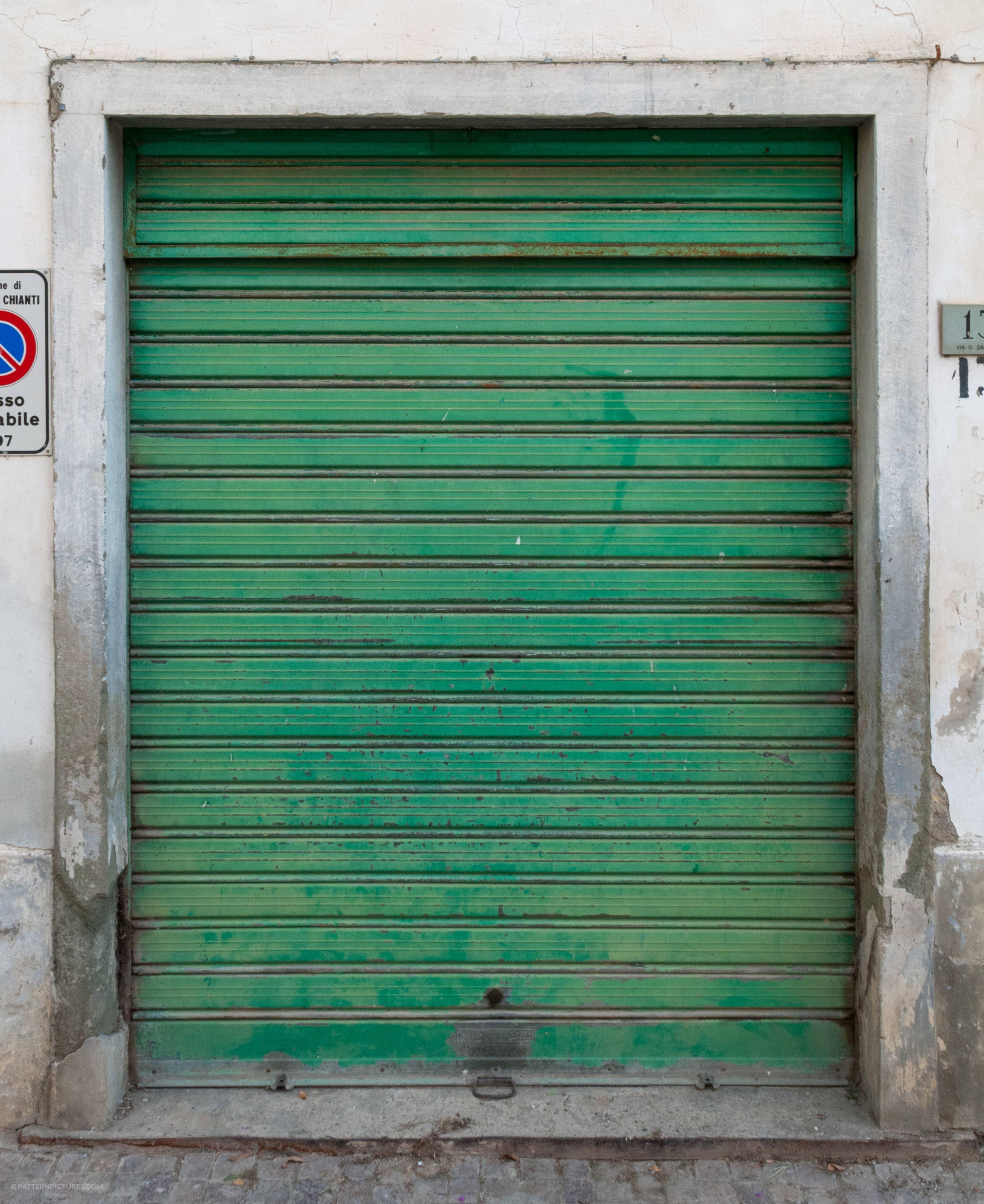 Green metal garage door background metal
