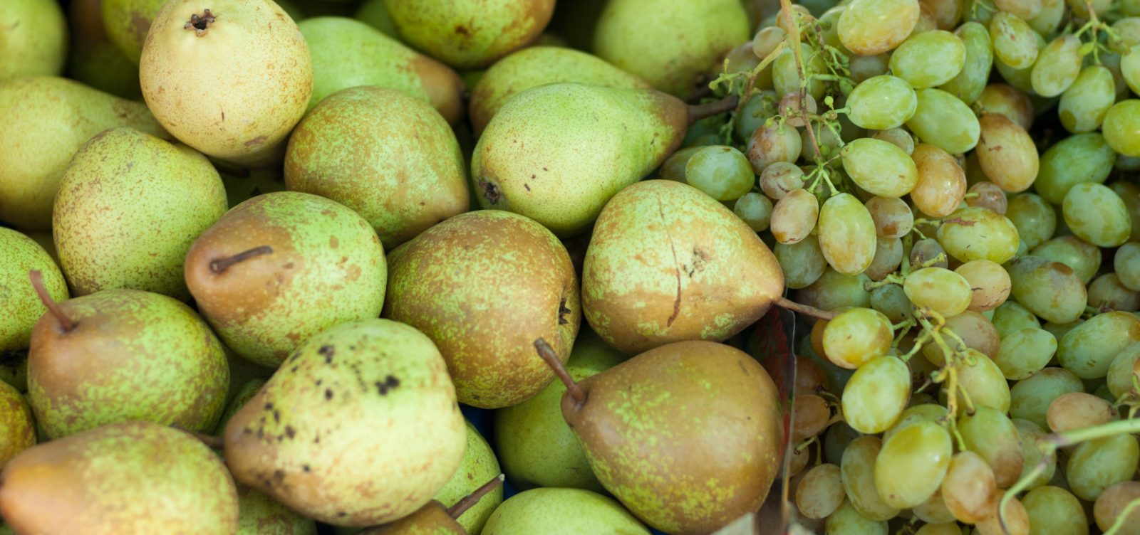Green pears and grapes market fruit texture