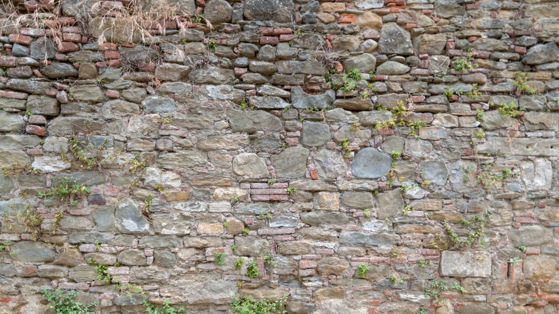 Grunge old stone brick wall texture