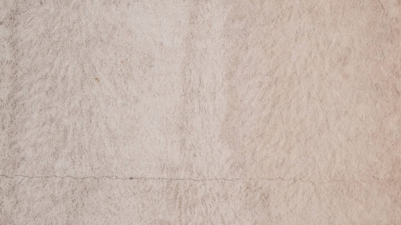 Grunge stone wall plaster with burst
