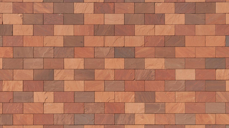 Heavy red stone facade bricks wall background