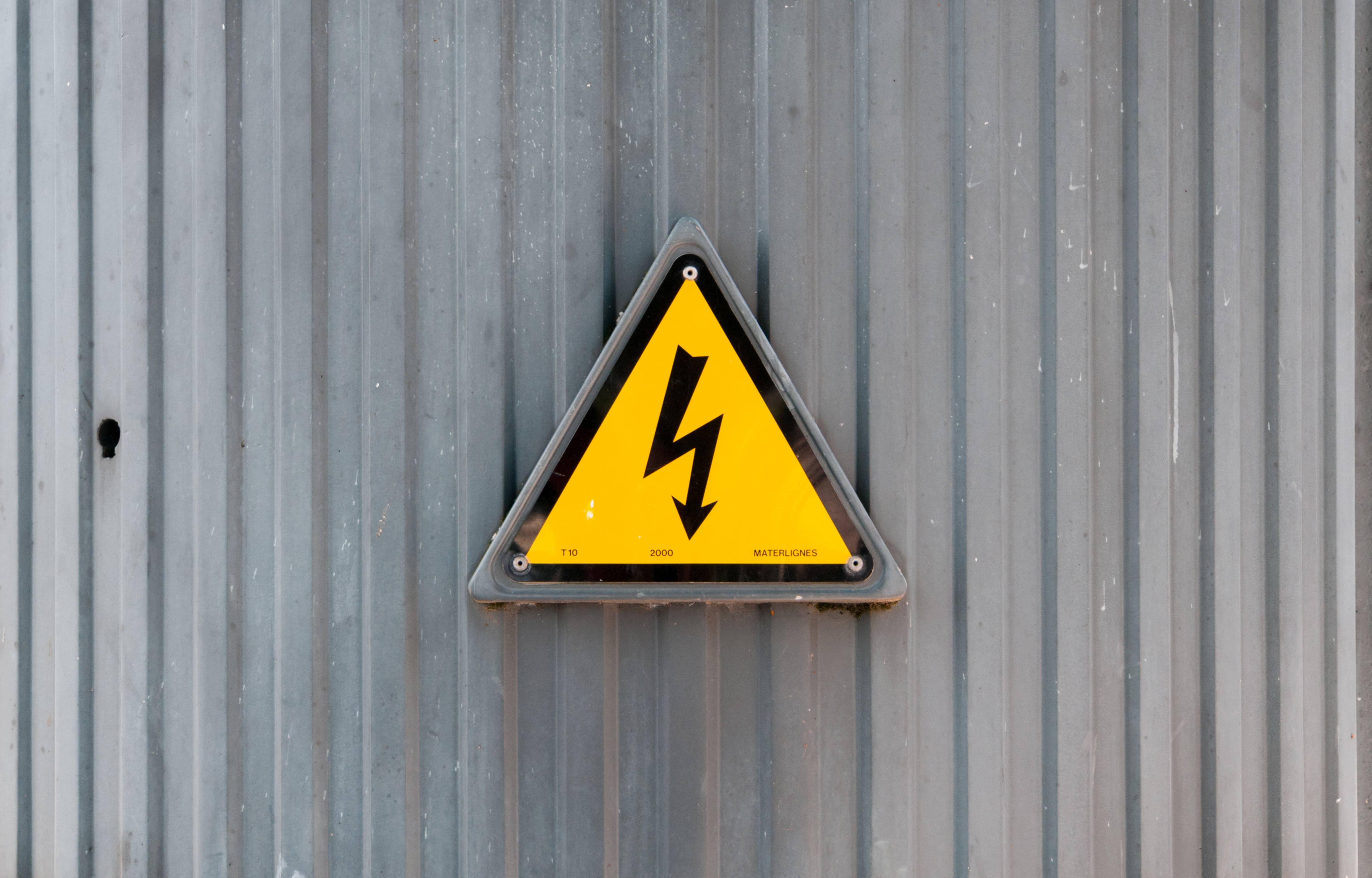 High voltage symbol on metal