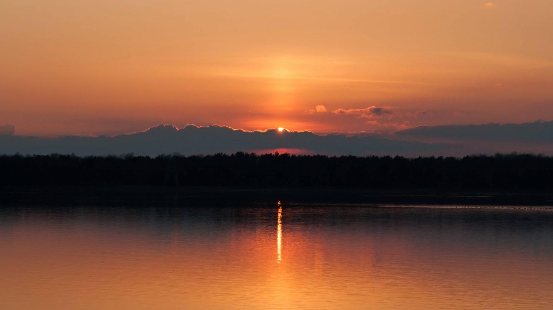 Lake sunset light beam