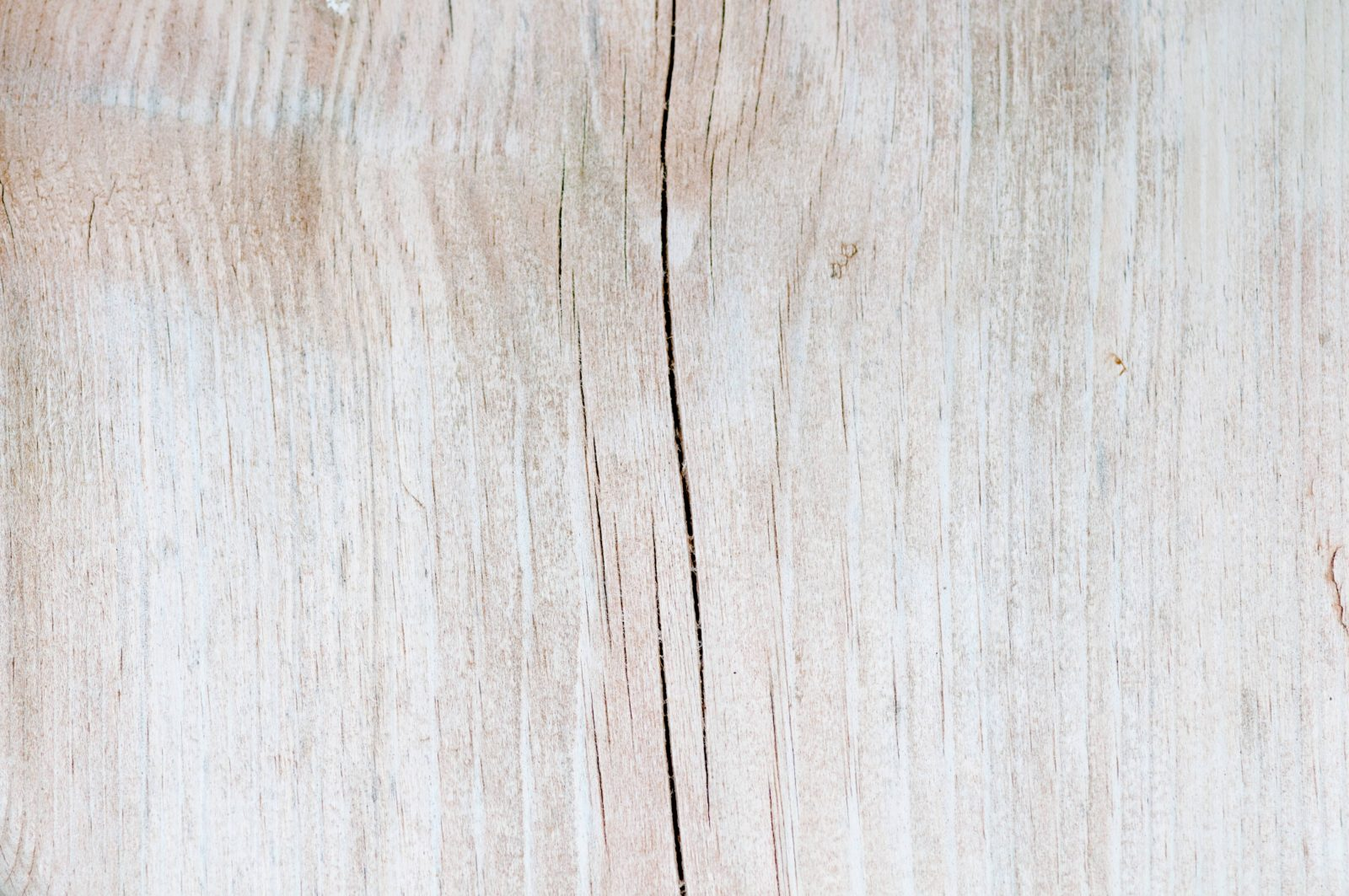 Light wood background texture with subtle cracks