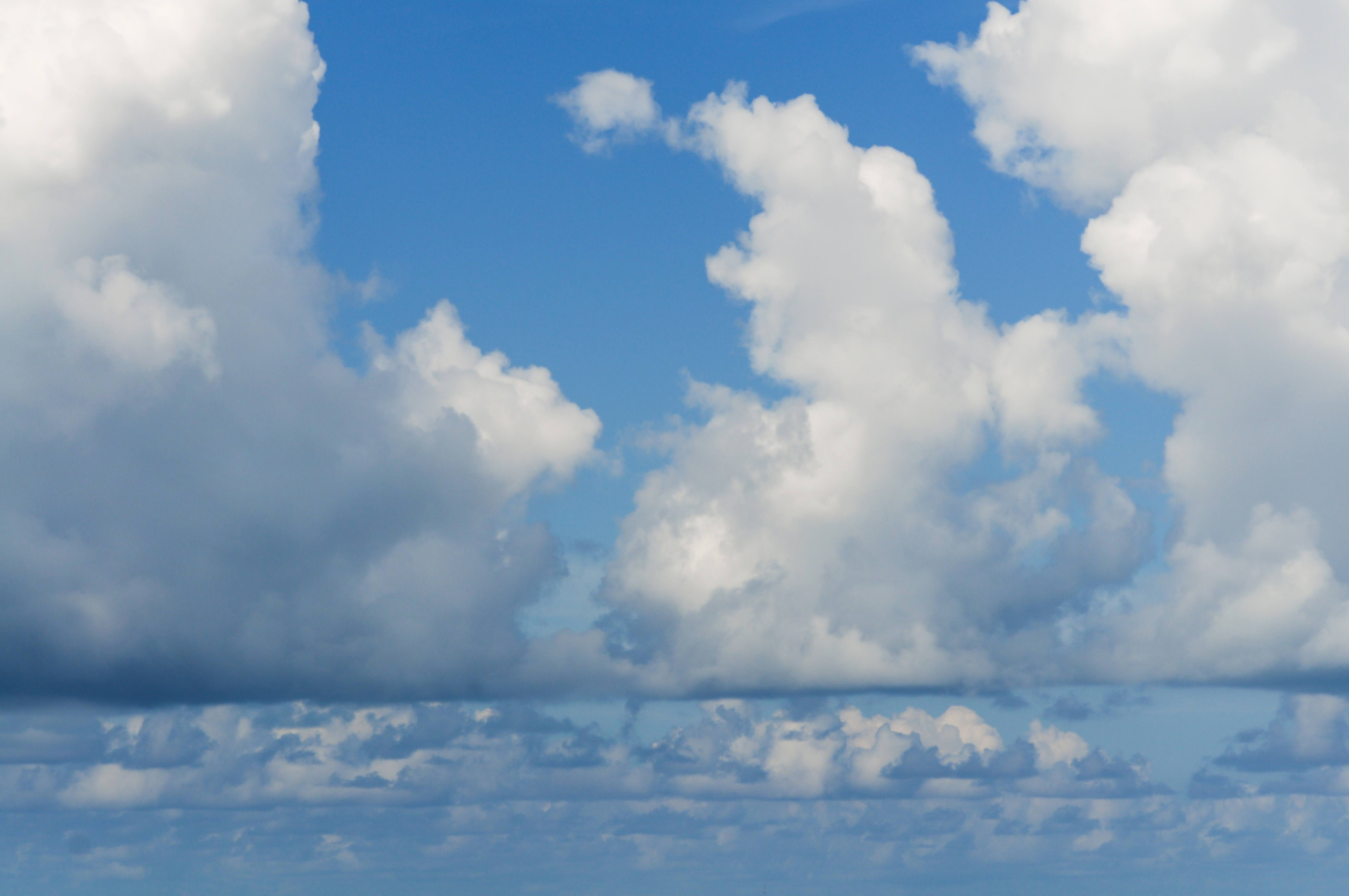 Low White Clouds on a Blue Sky Backdrop