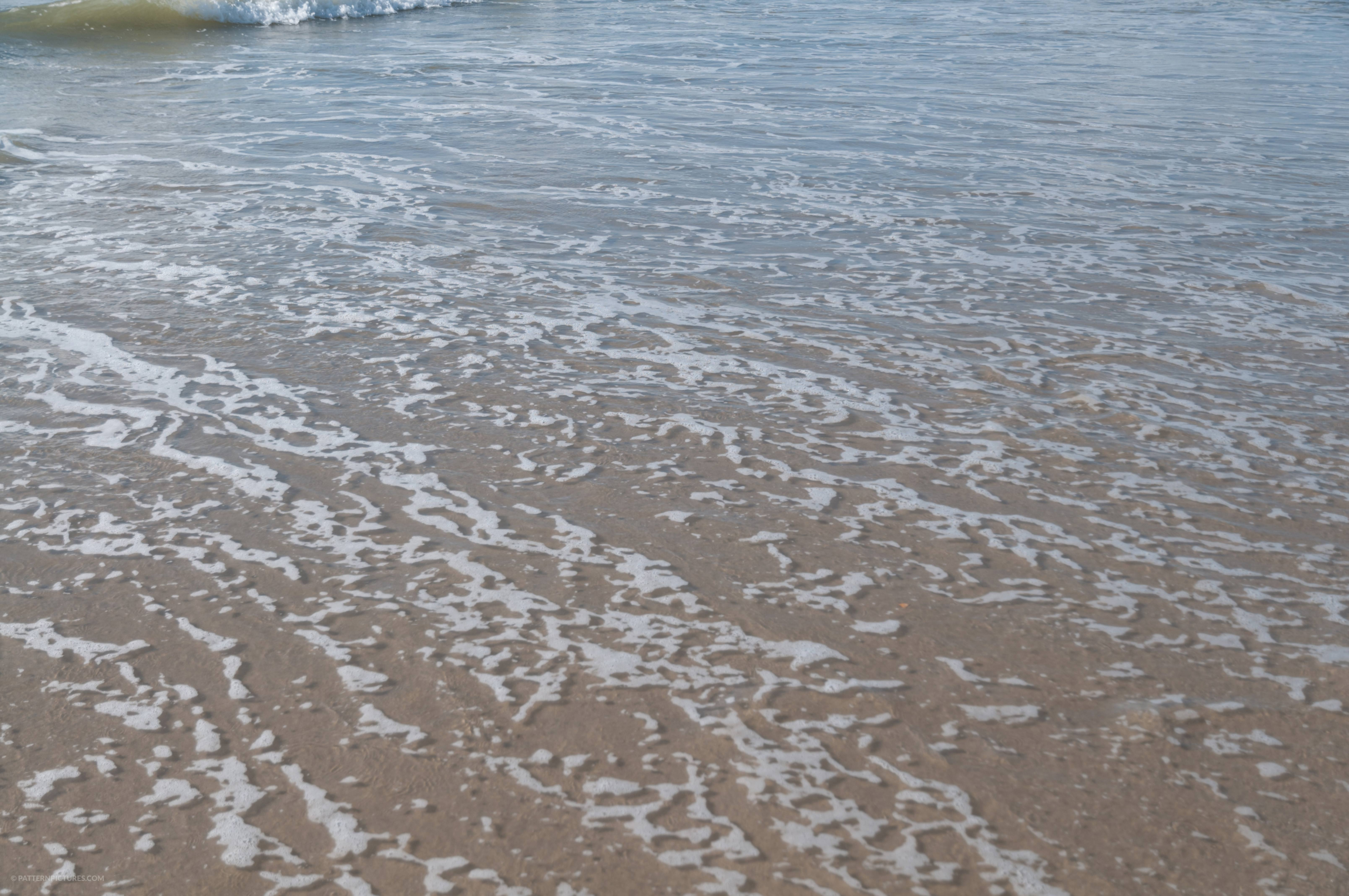 Low surface water beach shore close up