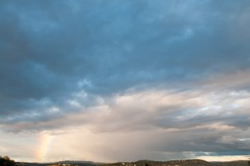 Mid-level clouds and rainbow