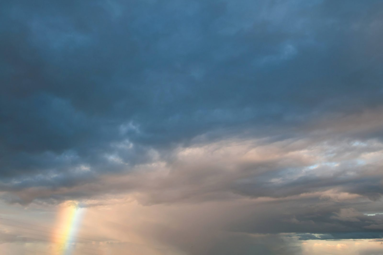Cloudy sky and rainbow background