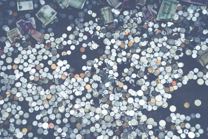 Money coins wishing well