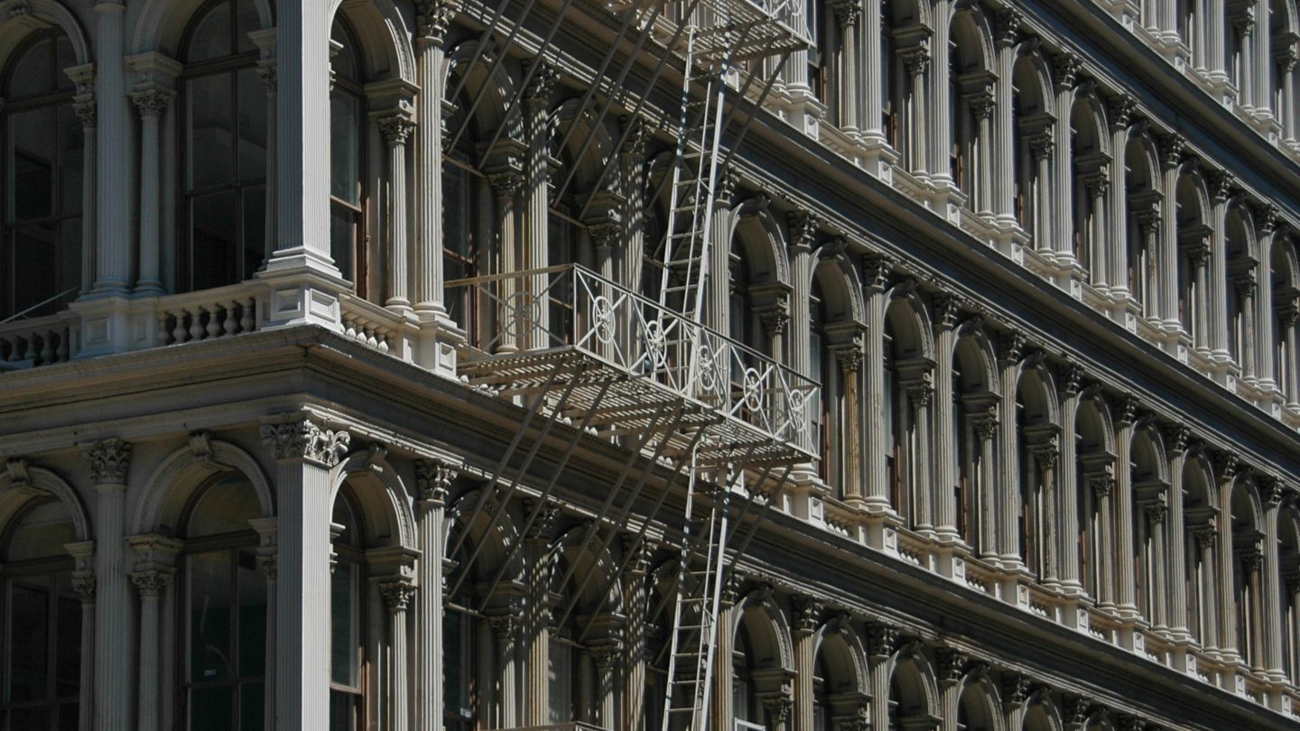 New York old building facade with fire stairs