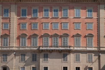 Old Italian building facade shutters closed