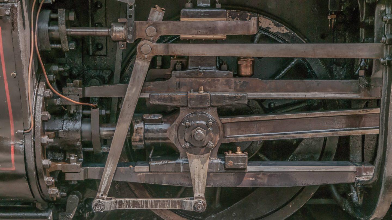 Old Locomotive wheels industrial background