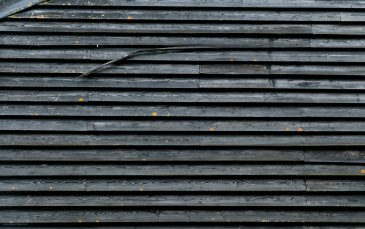 Old black wooden house wall surface