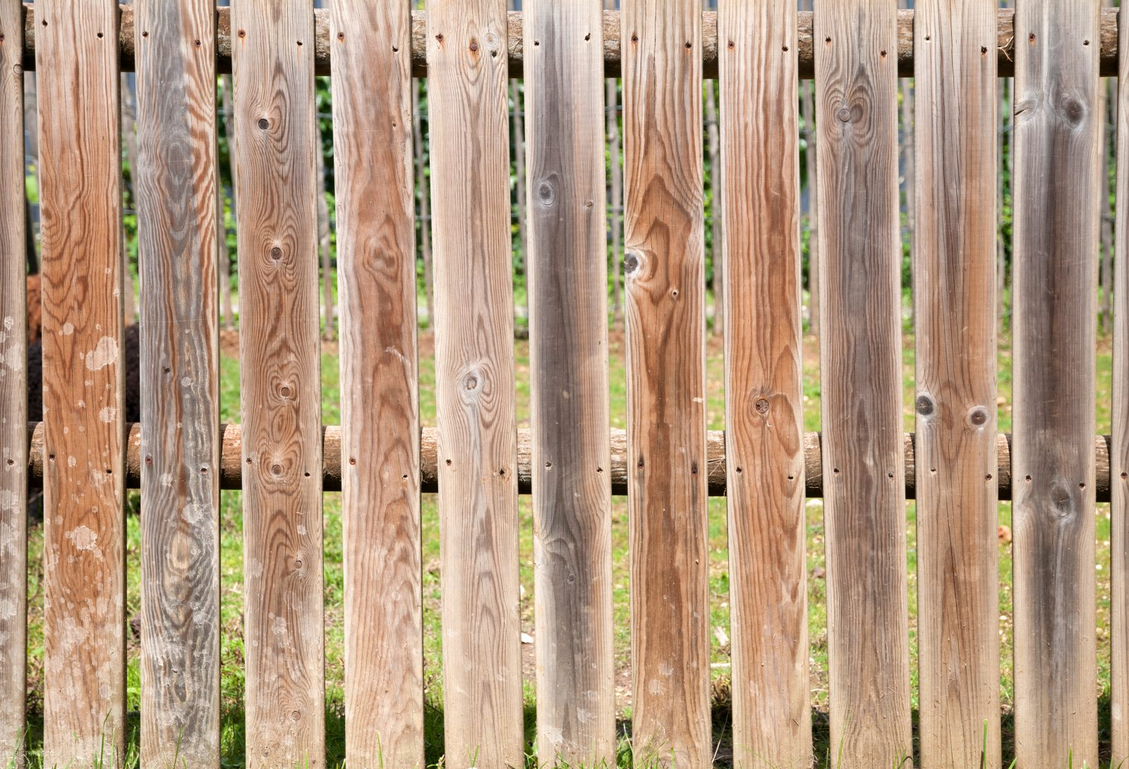 Old crooked wooden fence background