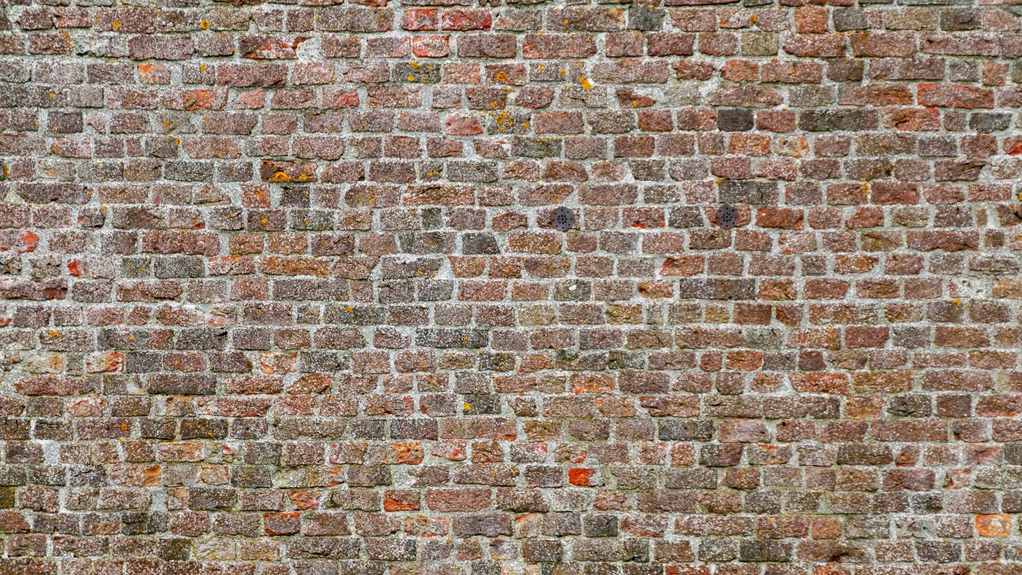 Old small bricks wall background