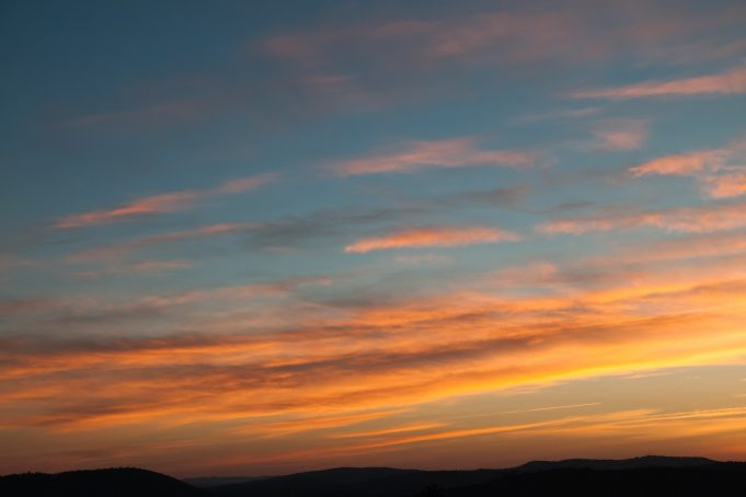 Orange and blue sunrise clouds