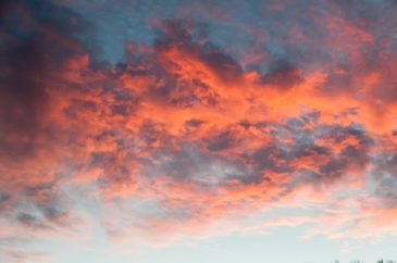 Orange fractured clouds sunset sky