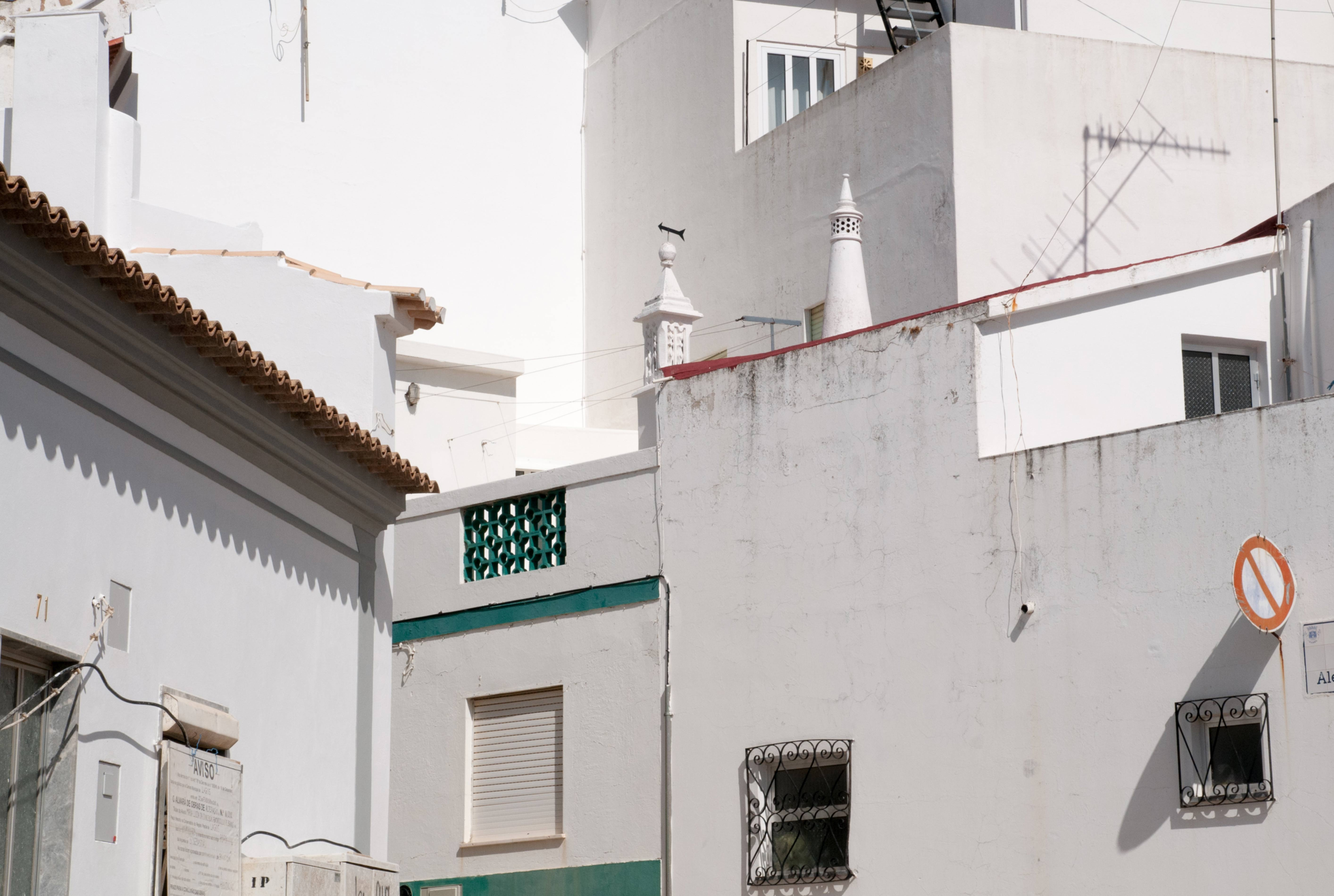 Corner of Houses with Only White Walls